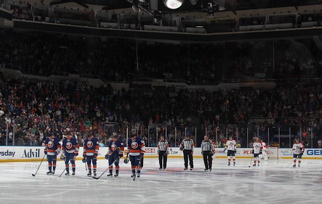 UNIONDALE, NY - APRIL 16: The New York Islanders and Florida Panthers stand for a moment of silence to commemorate the tradegy at the Boston Marathon prior to their game at the Nassau Veterans Memorial Coliseum on April 16, 2013 in Uniondale, New York. (Photo by Bruce Bennett/Getty Images)