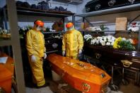 Gravediggers work as Argentine coronavirus death toll mounts amid a deadly second wave of infections