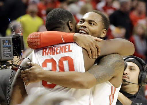 Ohio State forward Evan Ravenel (30) and Ohio State forward Deshaun Thomas celebrate after an NCAA college basketball game against the Wisconsin in the championship of the Big Ten tournament Sunday, March 17, 2013, in Chicago. Ohio State won 50-43. (AP Photo/Nam Y. Huh)