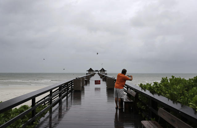 <p><strong>Naples</strong><br>Keith Gahagan takes a photo of the early effects of Hurricane Irma in Naples, Fla., Sept. 10, 2017. (Photo: David Goldman/AP) </p>