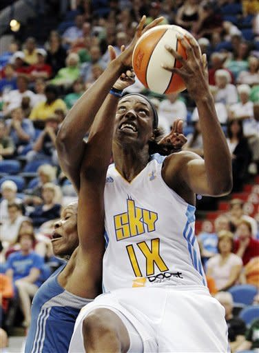 Chicago Sky center Sylvia Fowles, right, is fouled by Minnesota Lynx's Taj McWilliams-Franklin as she drives to the basket during the second half of a WNBA basketball game, Saturday June 23, 2012, in Minneapolis. Fowles had a team-high 22 points and the Lynx won 79-67. (AP Photo/Genevieve Ross)
