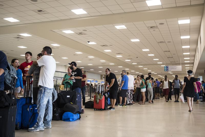 Travelers stand in line at Luis Muoz Marn International Airport in San Juan, Puerto Rico, on Monday. (Bloomberg via Getty Images)