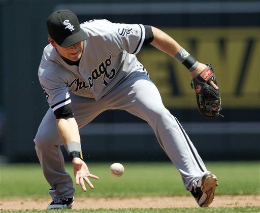 Chicago White Sox second baseman Gordon Beckham (15) fields a ground ball by hit by Kansas City Royals' Alcides Escobar during the third inning of a baseball game at Kauffman Stadium in Kansas City, Mo., Sunday, July 15, 2012. Escobar beat the throw and was safe at first base. (AP Photo/Orlin Wagner)