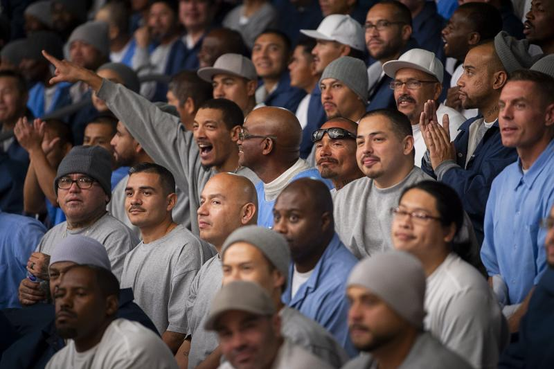 """In this Thursday, Dec. 12, 2019 photo, inmates watch inmates play basketball during the first NBA """"Play for Justice"""" event hosted by the Sacramento Kings and the Represent Justice Campaign at Folsom State Prison in Folsom, Calif. (Paul Kitagaki Jr./The Sacramento Bee via AP, Pool)"""