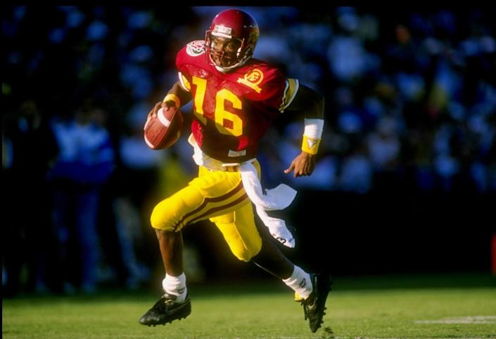 USC quarterback Rodney Peete runs with the ball against Michigan in the 1989 Rose Bowl.
