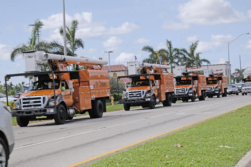 Utility trucks head for the Florida Keys as part of a massive effort to restore power following Hurricane Irma (AFP Photo/Gaston De Cardenas)