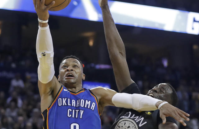 Thunder star Russell Westbrook catches Warriors forward with an elbow on his way to the basket. (AP)