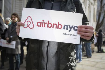 "Supporters of Airbnb stand during a rally before a hearing called ""Short Term Rentals: Stimulating the Economy or Destabilizing Neighborhoods?"" at City Hall in New York, January 2015. REUTERS/Shannon Stapleton"