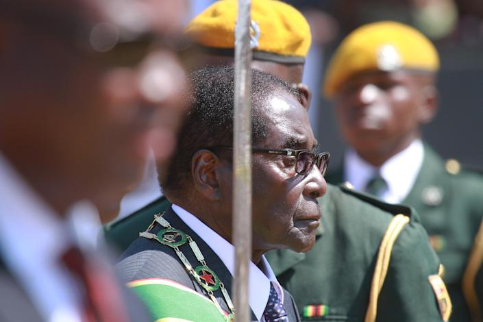 Zimbabwean President elect Robert Mugabe arrives at the country's Commemoration of Heroes day in Harare, Zimbabwe Monday, Aug. 12, 2013. Mugabe received more than 60 percent of the vote in just ended Presidential elections while his main challenger Morgan Tsvangirai is challenging the results in court and declaring the election null and void. (AP Photo/Tsvangirayi Mukwazhi)