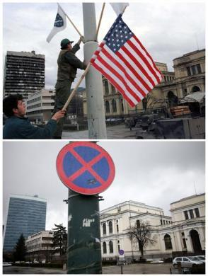 Workers put up Bosnian and U.S. national flags ahead of a visit by U.S. President Bill Clinton in Sarajevo (top), in this file picture taken December 21, 1997, and the parliament building and National Museum are seen in Sarajevo April 1, 2012, in this combination picture made April 4, 2012.