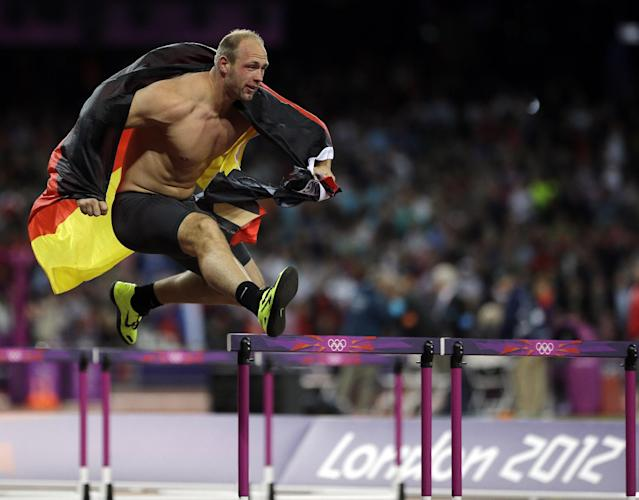 Germany's Robert Harting celebrates his gold medal win in the men's discus during the athletics in the Olympic Stadium at the 2012 Summer Olympics, London, Tuesday, Aug. 7, 2012. (AP Photo/Matt Slocum)