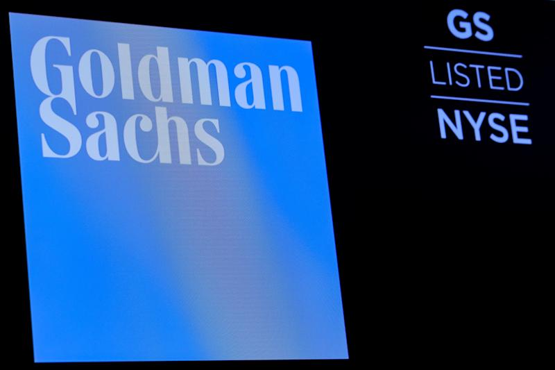 The ticker symbol and logo for Goldman Sachs is displayed on a screen on the floor at the New York Stock Exchange (NYSE) in New York, U.S., December 18, 2018. REUTERS/Brendan McDermid