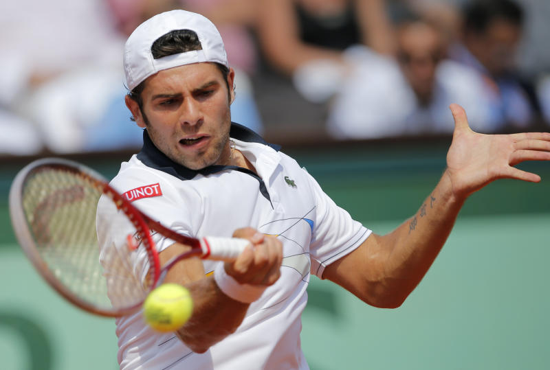 Italy's Simone Bolelli returns the ball to defending champion Spain's Rafael Nadal during their first round match in the French Open tennis tournament at the Roland Garros stadium in Paris, Tuesday, May 29, 2012. (AP Photo/Christophe Ena)