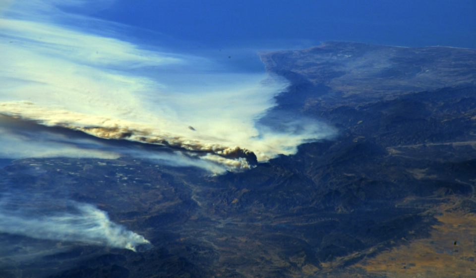 <p>Huge plumes of work are seen across California from space (Picture: Reuters) </p>