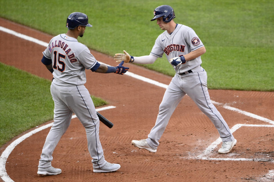 Houston Astros' Myles Straw, right, celebrates his home run with Martin Maldonado (15) during the second inning of a baseball game against the Baltimore Orioles, Tuesday, June 22, 2021, in Baltimore. (AP Photo/Nick Wass)