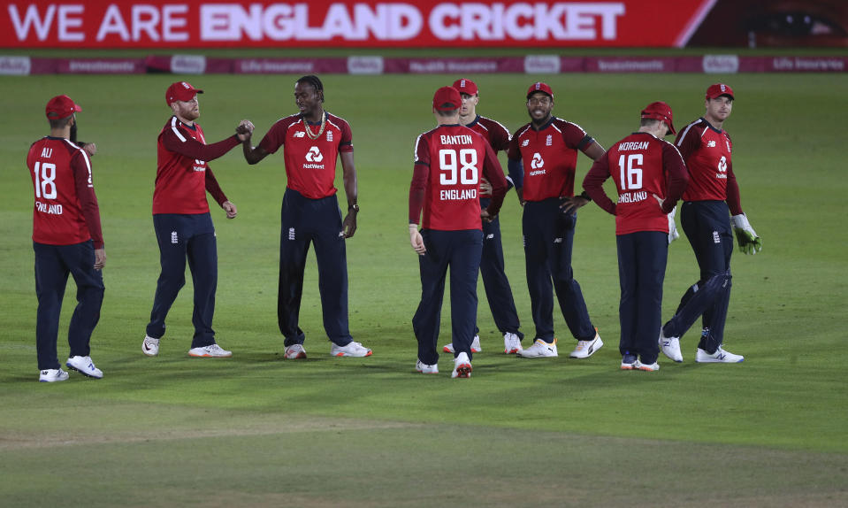 England's Jofra Archer, third left, celebrates with teammates the dismissal of Australia's captain Aaron Finch during the first Twenty20 cricket match between England and Australia, at the Ageas Bowl in Southampton, England, Friday, Sept. 4, 2020. (Andrew Matthews/Pool via AP)
