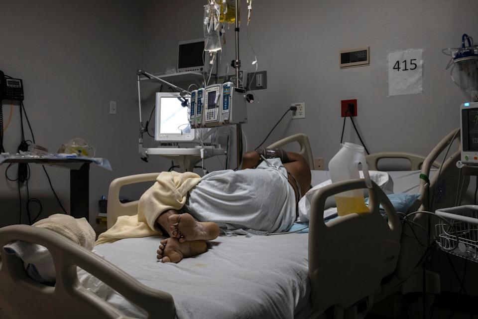 A patient is seen lying on a bed in the Covid-19 intensive care unit (ICU) on New Year's Day at the United Memorial Medical Center in Houston, Texas.