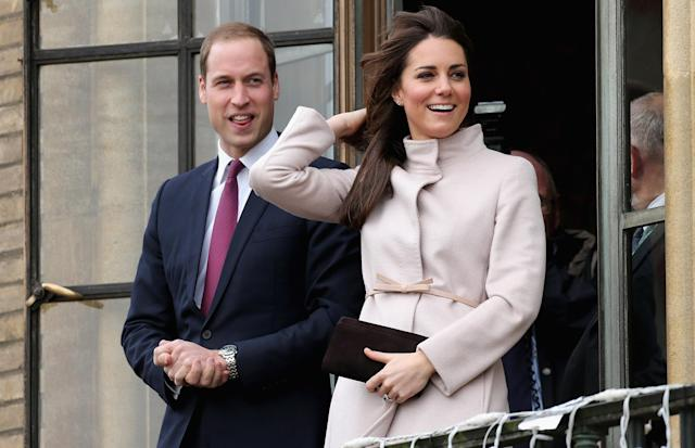 CAMBRIDGE, UNITED KINGDOM - NOVEMBER 28: Catherine, Duchess of Cambridge and Prince William, Duke of Cambridge smile and wave to the crowds from the balcony of Cambridge Guildhall as they pay an official visit to Cambridge on November 28, 2012 in Cambridge, England. (Photo by Chris Jackson/Getty Images)