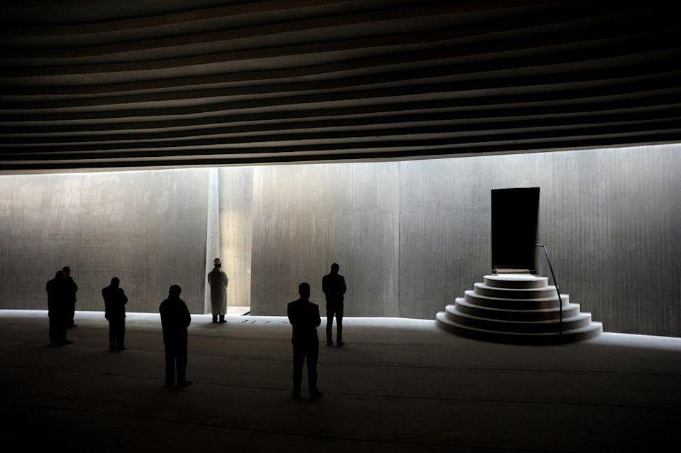 <p>Worshipper wait to enter this modern and non-traditional mosque in Istanbul, Turkey. (Bulent Suberk) </p>