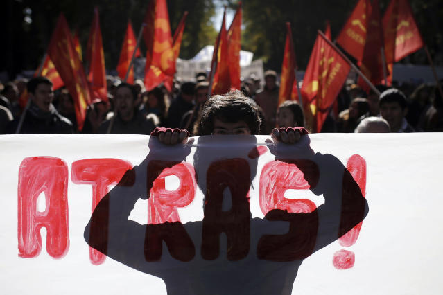 <p>Marchers protest government austerity measures, in Madrid, Nov. 23, 2013. (AP Photo/Andres Kudacki) </p>