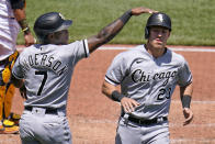 Chicago White Sox's Tim Anderson (7) and Jake Lamb celebrate after scoring on a double by Yasmani Grandal off Pittsburgh Pirates starting pitcher Chase De Jong during the fifth inning a baseball game in Pittsburgh, Wednesday, June 23, 2021. (AP Photo/Gene J. Puskar)