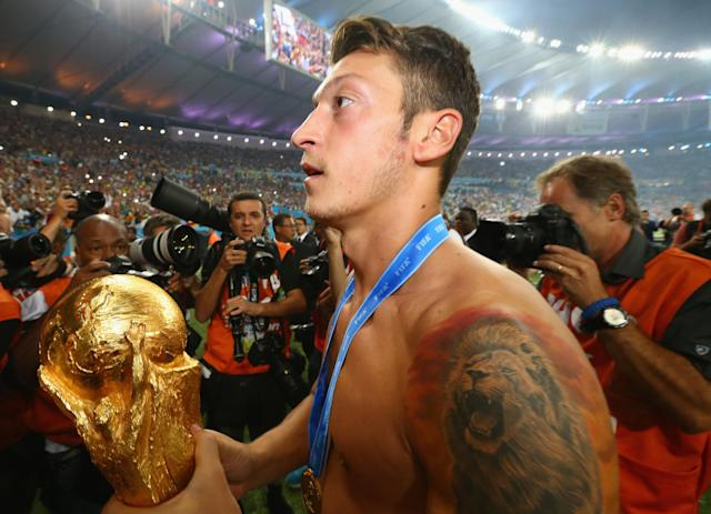 Ozil lifted the World Cup with Germany in the 2014 edition of the tournament, in Brazil. (Photo by Martin Rose/Getty Images)