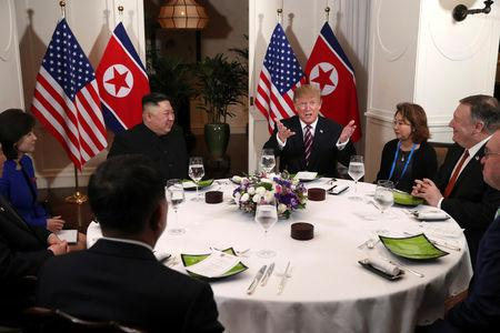 FILE PHOTO - U.S. President Donald Trump and North Korean leader Kim Jong Un sit down for a dinner during the second U.S.-North Korea summit at the Metropole Hotel in Hanoi, Vietnam February 27, 2019. Also pictured at right are U.S. Secretary of State Mike Pompeo and Acting White House Chief of Staff Mick Mulvaney  REUTERS/Leah Millis/File Photo
