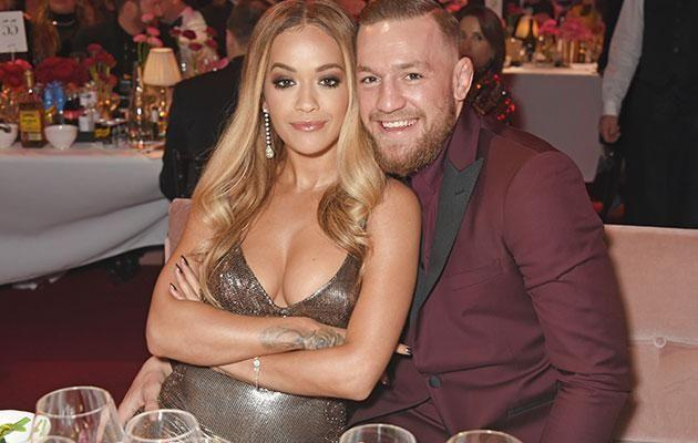 The singer and Connor McGregor get cosy at the Fashion Awards. Source: Getty