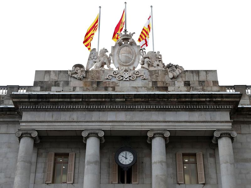 The regional government headquarters, the Generalitat, at ten o'clock: the final deadline set by Spain's government for Catalan President Carles Puigdemont to retract an ambiguous independence declaration: Reuters