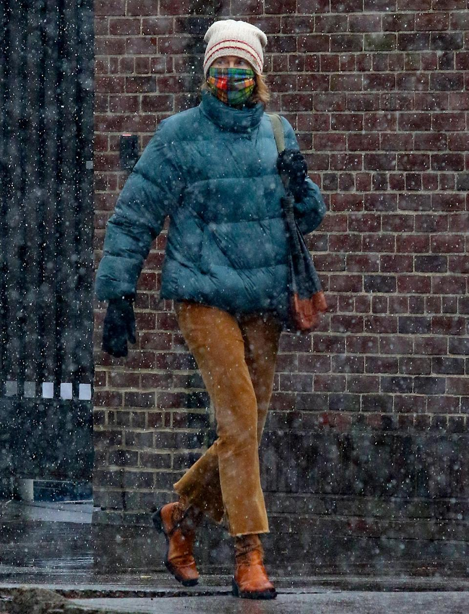 <p>Naomi Watts braves the first snowfall in N.Y.C. on Wednesday, wearing a teal puffer coat, a beanie and brown boots.</p>