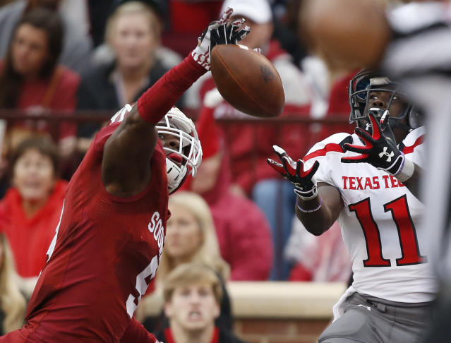 Oklahoma defensive back Gabe Lynn (9) knocks down a pass intended for Texas Tech wide receiver Jakeem Grant (11) in the first quarter of an NCAA college football game in Norman, Okla., Saturday, Oct. 26, 2013. (AP Photo/Sue Ogrocki)