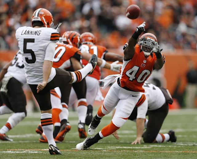 Cincinnati Bengals strong safety Shawn Williams (40) blocks a second-quarter punt by Cleveland Browns' Spencer Lanning (5) during an NFL football game in Cincinnati, Sunday, Nov. 17, 2013. (AP Photo/The Enquirer, Jeff Swinger)