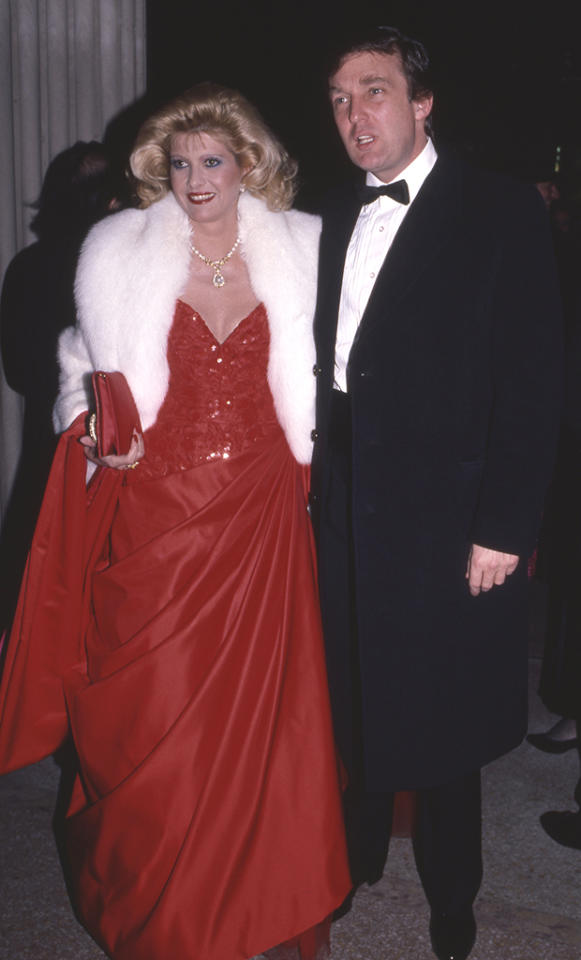 "<p>Ivana's plans of becoming a celebrity included <a rel=""nofollow"" href=""http://www.vanityfair.com/magazine/2015/07/donald-ivana-trump-divorce-prenup-marie-brenner"">studying royalty and taking notes</a>, according to <em>Vanity Fair. </em>Tell us they don't look as if they're trying to be royalty here in December 1986. Ivana wore a look-at-me low-cut red gown with a white fur and jewels, while Donald was back in the monkey suit, which could have used an adjustment in the wrinkly shirt area. (Photo: Sonia Moskowitz/Getty Images) </p>"
