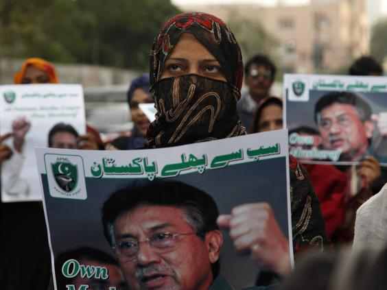Supporters of former Pakistani military ruler General Pervez Musharraf protest a court's death sentence decision, in Karachi Wednesday Jan 1 2020 (AP/Ikram Suri)