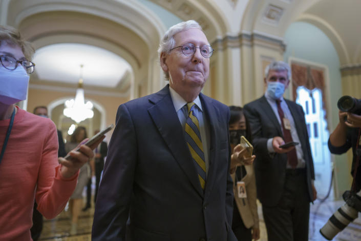 Senate Minority Leader Mitch McConnell, R-Ky., is surrounded by journalists as he walks to the Senate Chamber for a vote as Democrats look for a way to lift the debt limit without Republican votes, at the Capitol in Washington, Wednesday, Oct. 6, 2021. (AP Photo/J. Scott Applewhite)