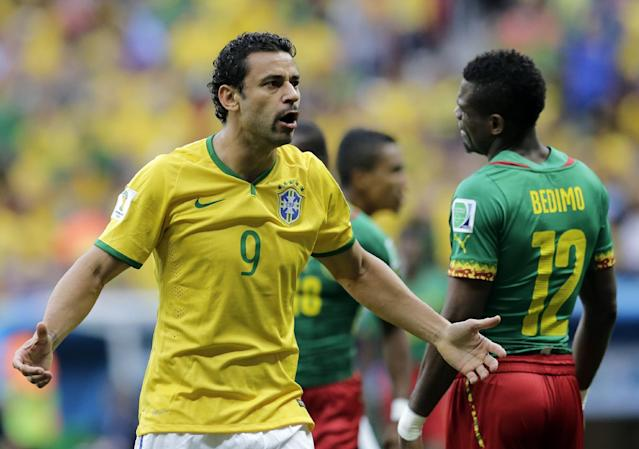 Brazil's Fred questions a line call during the group A World Cup soccer match between Cameroon and Brazil at the Estadio Nacional in Brasilia, Brazil, Monday, June 23, 2014. (AP Photo/Bernat Armangue)