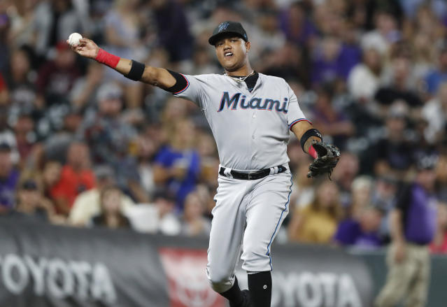 Miami Marlins third baseman Starlin Castro throws to first base to put out Colorado Rockies' Jon Gray to end the seventh inning of a baseball game Friday, Aug. 16, 2019, in Denver. (AP Photo/David Zalubowski)