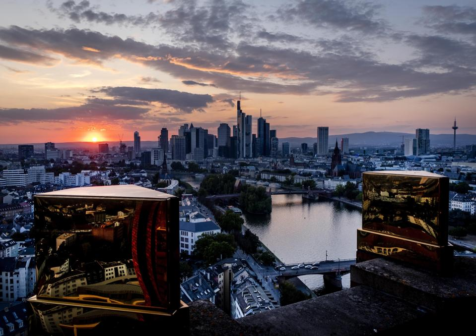 The city's skyline is seen between two golden pinnacles on top of a hotel in Frankfurt, Germany, Tuesday, Sept. 22, 2020. (AP Photo/Michael Probst)