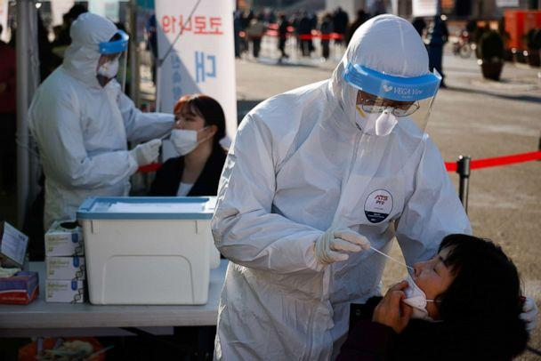 PHOTO: People undergo COVID-19 tests at a coronavirus testing site which is temporarily set up in front of a railway station in Seoul, Dec. 21, 2020.  (Kim Hong-ji/Reuters, FILE)
