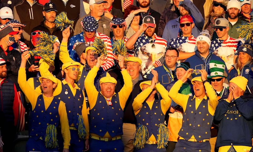 Team Europe fans cheer from the first tee box.