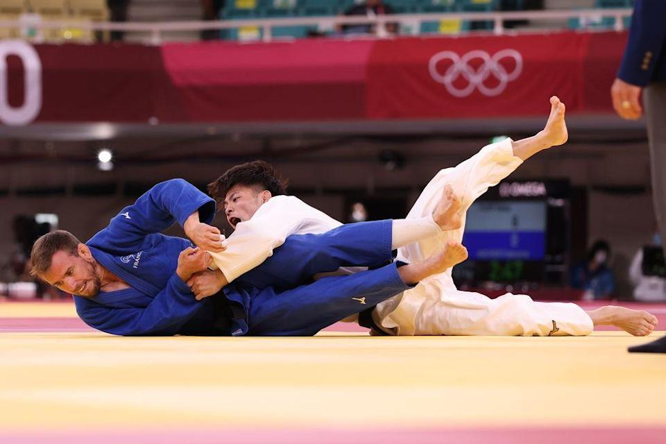 <p>Hifumi Abe of Team Japan defeats Kilian le Blouch of Team France during the Men's Judo competition, taking home the gold.</p>