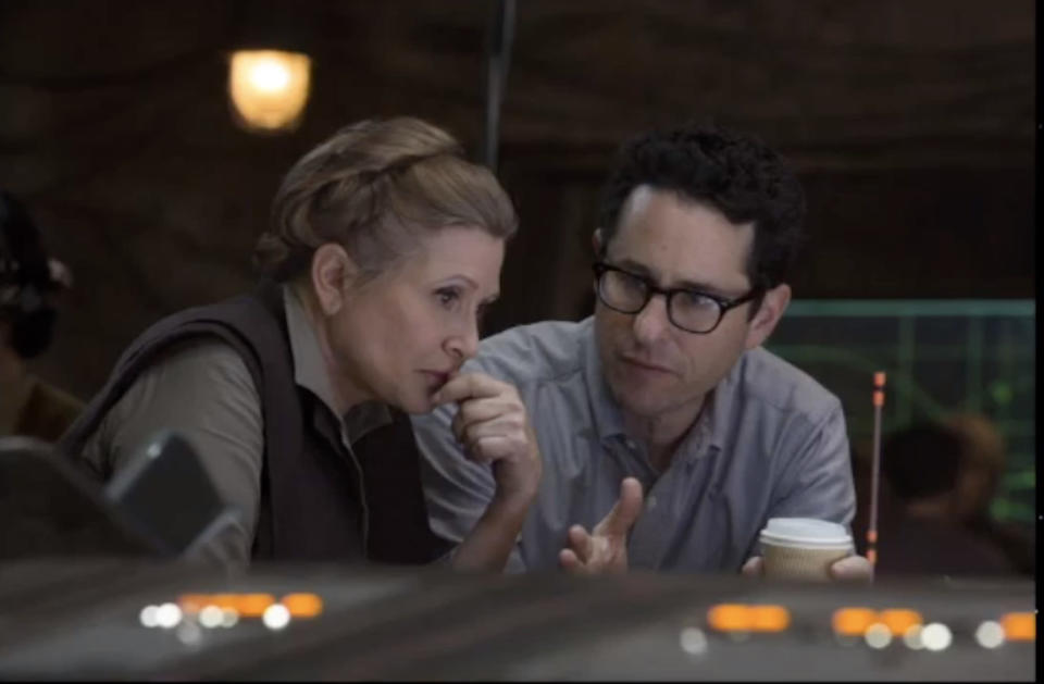 Carrie Fisher and J.J. Abrams on the set of 'Star Wars: The Force Awakens' (Photo: Walt Disney/YouTube)