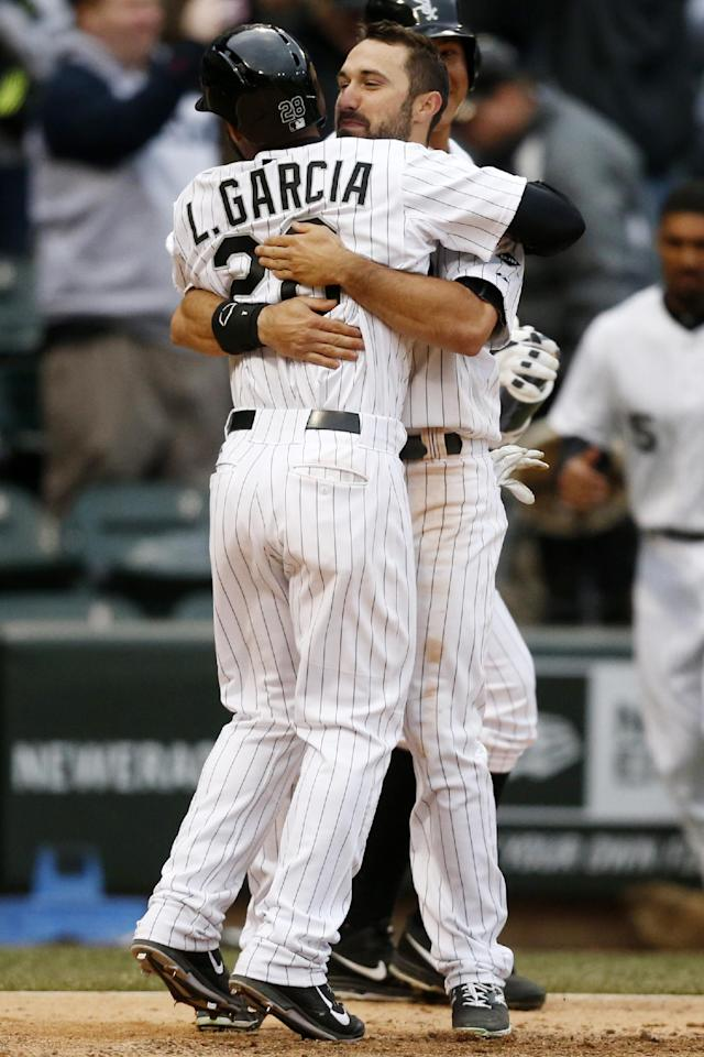 Chicago White Sox's Leury Garcia (28) celebrates with teammate Adam Eaton after scoring to end a baseball game in the eleventh inning on Wednesday, April 2, 2014, in Chicago. The White Sox won 7-6. (AP Photo/Andrew A. Nelles)