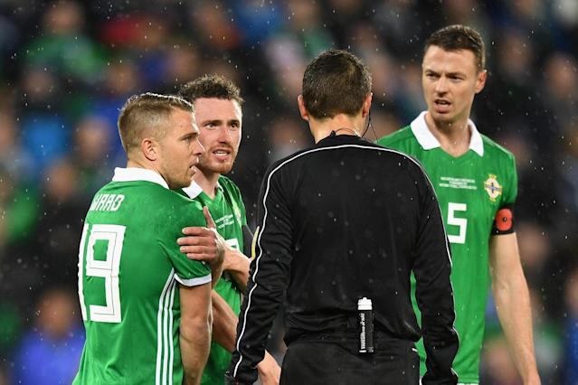 No shoulder to cry on: The Northern Ireland players furious with referee's Switzerland penalty decision
