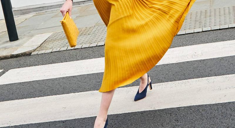 Boden's yellow pleated midi-skirt for spring/summer [Photo: Boden]