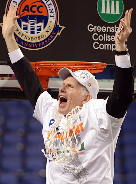 FILE- In this March 17, 2013, file photo, Miami head coach Jim Larranaga cheers after cutting the final strand of the net following their 87-77 win over North Carolina in an NCAA college basketball game for the championship in the Atlantic Coast Conference tournament in Greensboro, N.C. Larranaga, who led Miami to the Atlantic Coast Conference regular season and tournament titles and a No. 2 ranking, has been selected The Associated Press' coach of the year on Thursday, April 4, 2013. (AP Photo/The Times-News, Scott Muthersbaugh, File0