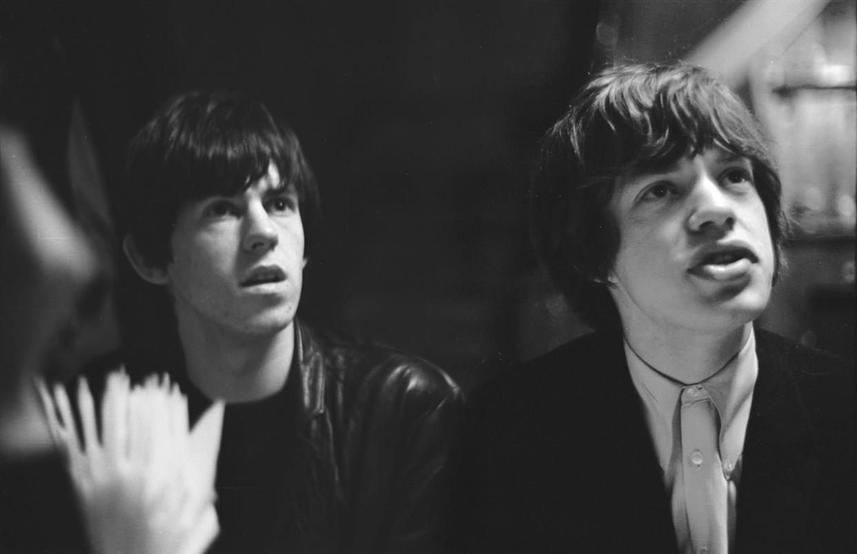 UNITED KINGDOM - JANUARY 01: Photo of The Glimmer Twins; Rolling Stones songwriters Keith Richard & Mick Jagger take time out from photo session, London, 1963 (Photo by John Hoppy Hopkins/Redferns)