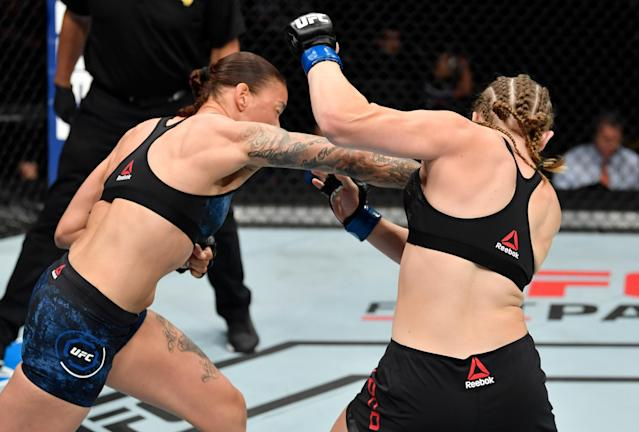 (L-R) Germaine de Randamie punches Aspen Ladd in their women's bantamweight bout during UFC Sacramento on Saturday. (Getty Images)