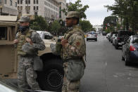 Members of the DC National Guard block an intersection on 16th Street as demonstrators gather to protest the death of George Floyd, Tuesday, June 2, 2020, near the White House in Washington. Floyd died after being restrained by Minneapolis police officers. (AP Photo/Jacquelyn Martin)