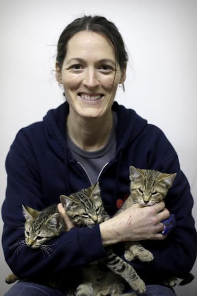 In this Thursday, March 28, 2013 photo, Red Paw founder Jen Leary poses for a portrait at their adoption facility in Philadelphia, with kittens displaced due to fires. The emergency relief service Red Paw has paired with the local Red Cross to care for animals displaced by flames, floods or other residential disasters, with the goal of eventually reuniting them with their owners. (AP Photo/Matt Rourke)
